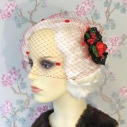 Red dotty birdcage veil.
