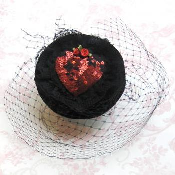 Ruby red heart cocktail hat.